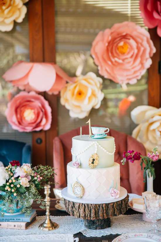 ariana-in-alice-in-wonderland-first-birthday-party-cake-on-timber